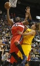 Oct 23, 2013; Cincinnati, OH, USA; Washington Wizards center Nene Hilario (42) goes up for a shot against Cleveland Cavaliers forward Anderson Varejao (17) during the first half at US Bank Arena. Mandatory Credit: David Kohl-USA TODAY Sports