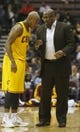 Oct 23, 2013; Cincinnati, OH, USA; Cleveland Cavaliers head coach Mike Brown (right) talks with point guard Jarrett Jack (1) in the first half during their game with the Washington Wizards at US Bank Arena. Mandatory Credit: David Kohl-USA TODAY Sports
