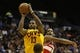 Oct 23, 2013; Cincinnati, OH, USA; Cleveland Cavaliers forward Tristan Thompson (13) goes up for a shot against Washington Wizards forward Trevor Ariza (1) at US Bank Arena. Mandatory Credit: David Kohl-USA TODAY Sports