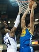Oct 23, 2013; Sacramento, CA, USA; Golden State Warriors center Andrew Bogut (12) dunks the ball during the second quarter against Sacramento Kings power forward Jason Thompson (34) at Sleep Train Arena. Mandatory Credit: Ed Szczepanski-USA TODAY Sports