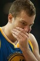 Oct 23, 2013; Sacramento, CA, USA; Golden State Warriors center David Lee (10) reacts after getting hit in the face during the fourth quarter of the game against the Sacramento Kings at Sleep Train Arena. Mandatory Credit: Ed Szczepanski-USA TODAY Sports
