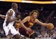 Oct 24, 2013; Charlotte, NC, USA; Cleveland Cavaliers forward center Anderson Varejao (17) looks to drive to the basket as he is defended by Charlotte Bobcats forward center Bismack Biyombo (0) during the game at Time Warner Cable Arena. Mandatory Credit: Sam Sharpe-USA TODAY Sports