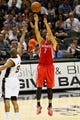 Oct 24, 2013; San Antonio, TX, USA; Houston Rockets guard Jeremy Lin (7) shoots against San Antonio Spurs guard Patrick Mills (8) during the second half at AT&T Center. Mandatory Credit: Soobum Im-USA TODAY Sports