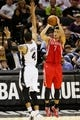 Oct 24, 2013; San Antonio, TX, USA; Houston Rockets guard Jeremy Lin (7) shoots against San Antonio Spurs guard Danny Green (4) during the second half at AT&T Center. The Rockets won 109-92. Mandatory Credit: Soobum Im-USA TODAY Sports