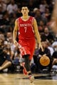 Oct 24, 2013; San Antonio, TX, USA; Houston Rockets guard Jeremy Lin (7) brings the ball up court during the second half against the San Antonio Spurs at AT&T Center. The Rockets won 109-92. Mandatory Credit: Soobum Im-USA TODAY Sports