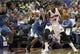 Oct 24, 2013; Auburn Hills, MI, USA; Detroit Pistons center Greg Monroe (10) defended by Minnesota Timberwolves power forward Dante Cunningham (33) during the second quarter at The Palace of Auburn Hills. Mandatory Credit: Raj Mehta-USA TODAY Sports