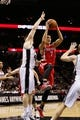 Oct 24, 2013; San Antonio, TX, USA; Houston Rockets guard Jeremy Lin (7) passes the ball under the basket against the San Antonio Spurs during the second half at AT&T Center. The Rockets won 109-92. Mandatory Credit: Soobum Im-USA TODAY Sports