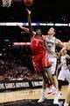 Oct 24, 2013; San Antonio, TX, USA; Houston Rockets guard Patrick Beverley (2) drives to the basket past San Antonio Spurs forward Aron Baynes (right) during the second half at AT&T Center. The Rockets won 109-92. Mandatory Credit: Soobum Im-USA TODAY Sports