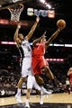 Oct 24, 2013; San Antonio, TX, USA; Houston Rockets guard Isaiah Canaan (1) drives to the basket under pressure from San Antonio Spurs guard Cory Joseph (5) during the second half at AT&T Center. The Rockets won 109-92. Mandatory Credit: Soobum Im-USA TODAY Sports