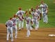 Oct 24, 2013; Boston, MA, USA; St. Louis Cardinals players celebrate on the field during game two of the MLB baseball World Series at Fenway Park. Mandatory Credit: Bob DeChiara-USA TODAY Sports
