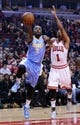Oct 25, 2013; Chicago, IL, USA; Denver Nuggets point guard Ty Lawson (3) shoots the ball against Chicago Bulls point guard Derrick Rose (1) during the first quarter at the United Center. Mandatory Credit: Mike DiNovo-USA TODAY Sports