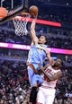 Oct 25, 2013; Chicago, IL, USA;  Denver Nuggets center JaVale McGee (34) dunks the ball against Chicago Bulls center Nazr Mohammed (48) during the first quarter at the United Center. Mandatory Credit: Mike DiNovo-USA TODAY Sports