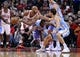 Oct 25, 2013; Chicago, IL, USA; Chicago Bulls power forward Taj Gibson (22) grabs a loose ball against Denver Nuggets shooting guard Evan Fournier (right) during the second quarter at the United Center. Mandatory Credit: Mike DiNovo-USA TODAY Sports