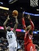 Oct 25, 2013; Memphis, TN, USA; Memphis Grizzlies power forward Zach Randolph (50) shoots the ball against Houston Rockets center Dwight Howard (12) during the second quarter at FedExForum. Mandatory Credit: Justin Ford-USA TODAY Sports