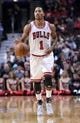 Oct 25, 2013; Chicago, IL, USA; Chicago Bulls point guard Derrick Rose (1) dribbles the ball against the Denver Nuggets during the second half at the United Center. Chicago defeats Denver 94-89. Mandatory Credit: Mike DiNovo-USA TODAY Sports