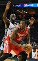 Oct 25, 2013; Memphis, TN, USA; Memphis Grizzlies small forward Quincy Pondexter (20) guards Houston Rockets small forward Robert Covington (33) during the fourth quarter at FedExForum. Memphis Grizzlies lose to Houston Rockets 92 - 73. Mandatory Credit: Justin Ford-USA TODAY Sports