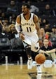 Oct 25, 2013; Memphis, TN, USA; Memphis Grizzlies point guard Mike Conley (11) brings the ball up court against Houston Rockets during the first quarter at FedExForum. The Rockets won 92-73. Mandatory Credit: Justin Ford-USA TODAY Sports