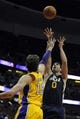 Oct 25, 2013; Anaheim, CA, USA; Utah Jazz center Enes Kanter (0) goes up for a shot while defended by Los Angeles Lakers forward Pau Gasol (16) during the first quarter at Honda Center. Mandatory Credit: Kelvin Kuo-USA TODAY Sports