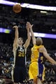 Oct 25, 2013; Anaheim, CA, USA; Utah Jazz forward Gordon Hayward (20) goes up for a shot while defended by Los Angeles Lakers guard Steve Blake (5) during the first quarter at Honda Center. Mandatory Credit: Kelvin Kuo-USA TODAY Sports