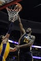 Oct 25, 2013; Anaheim, CA, USA; Utah Jazz forward Derrick Favors (15) goes up for a shot against the Los Angeles Lakers during the first quarter at Honda Center. Mandatory Credit: Kelvin Kuo-USA TODAY Sports