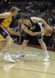 Oct 25, 2013; Anaheim, CA, USA; Utah Jazz forward Gordon Hayward (20) holds the ball while defended by Los Angeles Lakers guard Steve Blake (5) during the first quarter at Honda Center. Mandatory Credit: Kelvin Kuo-USA TODAY Sports