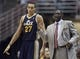 Oct 25, 2013; Anaheim, CA, USA; Utah Jazz head coach Tyrone Corbin talks to Utah Jazz center Rudy Gobert (27) during the game against the Los Angeles Lakers during the first quarter at Honda Center. Mandatory Credit: Kelvin Kuo-USA TODAY Sports