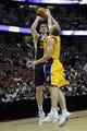 Oct 25, 2013; Anaheim, CA, USA; Utah Jazz forward Gordon Hayward (20) goes up for a shot while defended by Los Angeles Lakers guard Steve Blake (5) during the second quarter at Honda Center. Mandatory Credit: Kelvin Kuo-USA TODAY Sports