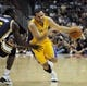 Oct 25, 2013; Anaheim, CA, USA; Los Angeles Lakers guard Jordan Farmar (1) drives the ball while defended by Utah Jazz guard Lester Hudson (6) during the fourth quarter at Honda Center. The Los Angeles Lakers defeated the Utah Jazz 111-106. Mandatory Credit: Kelvin Kuo-USA TODAY Sports