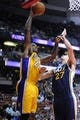 Oct 25, 2013; Anaheim, CA, USA; Los Angeles Lakers center Jordan Hill (27) goes up for a dunk while defended by Utah Jazz center Rudy Gobert (27) during the fourth quarter at Honda Center. The Los Angeles Lakers defeated the Utah Jazz 111-106. Mandatory Credit: Kelvin Kuo-USA TODAY Sports