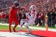 Oct 26, 2013; Piscataway, NJ, USA; Houston Cougars wide receiver Demarcus Ayers (10) catches a touchdown pass while being defended by Rutgers Scarlet Knights defensive back Nadir Barnwell during the first half at High Point Solutions Stadium. Mandatory Credit: Ed Mulholland-USA TODAY Sports