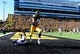 Oct 26, 2013; Iowa City, IA, USA; Iowa Hawkeyes tight end C.J. Fiedorowicz (86) makes an eight-yard touchdown reception as Northwestern Wildcats safety Traveon Henry (10) defends in overtime at Kinnick Stadium. Iowa won 17-10. Mandatory Credit: Byron Hetzler-USA TODAY Sports