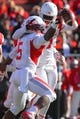 Oct 26, 2013; Piscataway, NJ, USA; Houston Cougars defensive back Turon Walker (5) celebrates his interception during the second half of their game against the Rutgers Scarlet Knights at High Point Solutions Stadium. Houston defeated Rutgers 49-14.  Mandatory Credit: Ed Mulholland-USA TODAY Sports