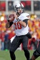 Oct 26, 2013; Ames, IA, USA; Oklahoma State Cowboys quarterback Clint Chelf (10) throws during the first quarter against the Iowa State Cyclones at Jack Trice Stadium. Oklahoma State defeated Iowa State 58-27. Mandatory Credit: Brace Hemmelgarn-USA TODAY Sports