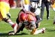 Oct 26, 2013; Ames, IA, USA; Iowa State Cyclones quarterback Sam B. Richardson (12) is sacked by Oklahoma State Cowboys defensive tackle Calvin Barnett (99) at Jack Trice Stadium.  The Cowboys beat the Cyclones 58-27.  Mandatory Credit: Reese Strickland-USA TODAY Sports
