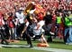 Oct 26, 2013; Ames, IA, USA; Iowa State Cyclones running back DeVondrick Nealy (20) leaps over Oklahoma State Cowboys safety Shamiel Gray (7) at Jack Trice Stadium.  The Cowboys beat the Cyclones 58-27.  Mandatory Credit: Reese Strickland-USA TODAY Sports