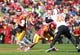 Oct 26, 2013; Ames, IA, USA; Iowa State Cyclones quarterback Sam B. Richardson (12) looks down field against the Oklahoma State Cowboys at Jack Trice Stadium.  The Cowboys beat the Cyclones 58-27.  Mandatory Credit: Reese Strickland-USA TODAY Sports