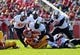 Oct 26, 2013; Ames, IA, USA; Iowa State Cyclones quarterback Grant Rohach (3) is sacked by Oklahoma State Cowboys defensive tackle Calvin Barnett (99) at Jack Trice Stadium.  The Cowboys beat the Cyclones 58-27.  Mandatory Credit: Reese Strickland-USA TODAY Sports