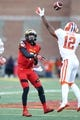 Oct 26, 2013; College Park, MD, USA; Maryland Terrapins quarterback Caleb Rowe (7) lofts a pass over Clemson Tigers safety Korrin Wiggins (12) at Byrd Stadium. Mandatory Credit: Mitch Stringer-USA TODAY Sports