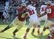 Oct 26, 2013; Tallahassee, FL, USA; Florida State Seminoles defensive tackle Timmy Jernigan (8) tackles North Carolina State Wolfpack running back Matt Dayes (21) during the second half at Doak Campbell Stadium. Mandatory Credit: Melina Vastola-USA TODAY Sports