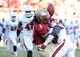 Oct 26, 2013; Tallahassee, FL, USA; Florida State Seminoles wide receiver Kelvin Benjamin (1) has the ball knocked loose by North Carolina State Wolfpack safety Hakim Jones (20) during the second half of the game at Doak Campbell Stadium. Mandatory Credit: Melina Vastola-USA TODAY Sports