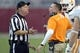 Oct 26, 2013; Tuscaloosa, AL, USA; Head linesman Gary Jayroe tries to explain a call as Tennessee Volunteers head coach Butch Jones reacts to the Alabama Crimson Tide maintaining possession on a loose ball during the fourth quarter at Bryant-Denny Stadium. Mandatory Credit: John David Mercer-USA TODAY Sports