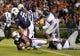 Oct 26, 2013; Auburn, AL, USA; Auburn Tigers running back Tre Mason (21) scores the first touchdown of the game against the Florida Atlantic Owls at Jordan Hare Stadium. Mandatory Credit: Shanna Lockwood-USA TODAY Sports