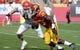 Oct 26, 2013; Los Angeles, CA, USA;  USC Trojans running back Silas Redd (25) tires to run past Utah Utes linebacker Jared Norris (41) during first half at Los Angeles Memorial Coliseum. The Trojans won 19-3. Mandatory Credit: Robert Hanashiro-USA TODAY Sports