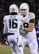 Oct 26, 2013; Lawrence, KS, USA; Baylor Bears wide receiver Tevin Reese (16) celebrates with offensive linesman Spencer Drango (58) after scoring a touchdown against the Kansas Jayhawks in the first half at Memorial Stadium. Mandatory Credit: John Rieger-USA TODAY Sports