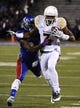 Oct 26, 2013; Lawrence, KS, USA; Baylor Bears wide receiver Robbie Rhodes (3) is tackled by Kansas Jayhawks cornerback JaCorey Shepherd (24) in the first half at Memorial Stadium. Mandatory Credit: John Rieger-USA TODAY Sports