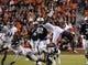 Oct 26, 2013; Auburn, AL, USA; Auburn Tigers wide receiver Sammie Coates (18) goes airborne over the defense of the Florida Atlantic Owls at Jordan Hare Stadium. Mandatory Credit: Shanna Lockwood-USA TODAY Sports