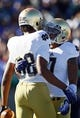 Oct 26, 2013; Colorado Springs, CO, USA; Notre Dame Fighting Irish wide receiver TJ Jones (7) congratulates wide receiver Corey Robinson (88) after his touchdown in the first quarter against the Air Force Falcons at Falcon Stadium. Mandatory Credit: Isaiah J. Downing-USA TODAY Sports