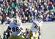Oct 26, 2013; Colorado Springs, CO, USA; Notre Dame Fighting Irish quarterback Tommy Rees (11) throws the ball over Notre Dame Fighting Irish guard Chris Watt (66) in the second quarter against the Air Force Falcons at Falcon Stadium. Mandatory Credit: Isaiah J. Downing-USA TODAY Sports