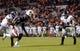 Oct 26, 2013; Auburn, AL, USA;  Florida Atlantic Owls defensive back Christian Milstead (18) intercepts a pass intended for Auburn Tigers wide receiver Tony Stevens (8) at Jordan Hare Stadium. The Tigers beat the Owls 45-10. Mandatory Credit: Shanna Lockwood-USA TODAY Sports