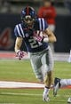 Oct 26, 2013; Oxford, MS, USA;  Mississippi Rebels wide receiver Jordan Holder (21) advances the ball during the game against the Idaho Vandals at Vaught-Hemingway Stadium. Mississippi Rebels win the game against the Idaho Vandals with a score of 59-14.  Mandatory Credit: Spruce Derden-USA TODAY Sports